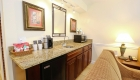 Granite wet bar in the living area